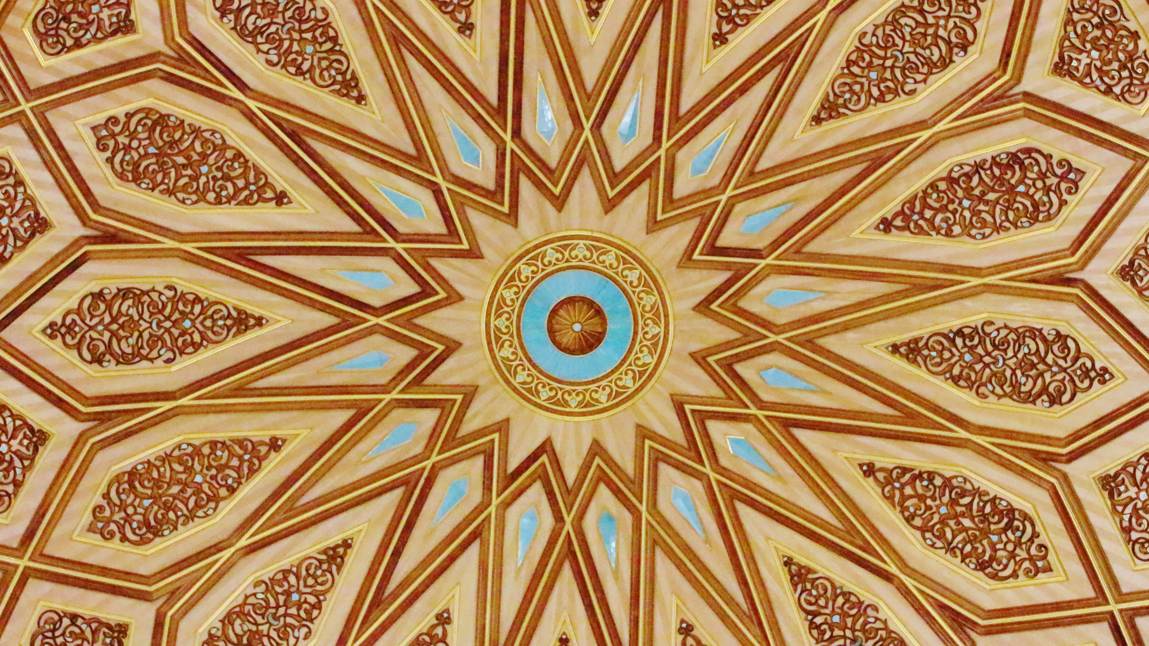 Brown and gold coloured geometric design with teal details gr